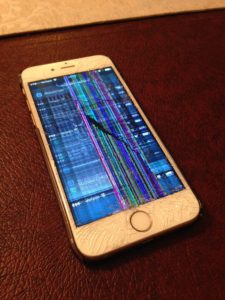 iPhone 6S cracked LCD display. Lines are appearing on the display