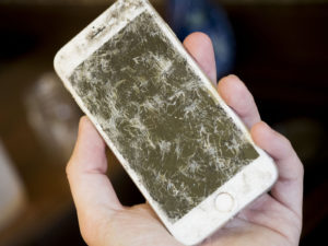 Blacked out display after you have dropped your phone. This means that your iPhone LCD is damaged.